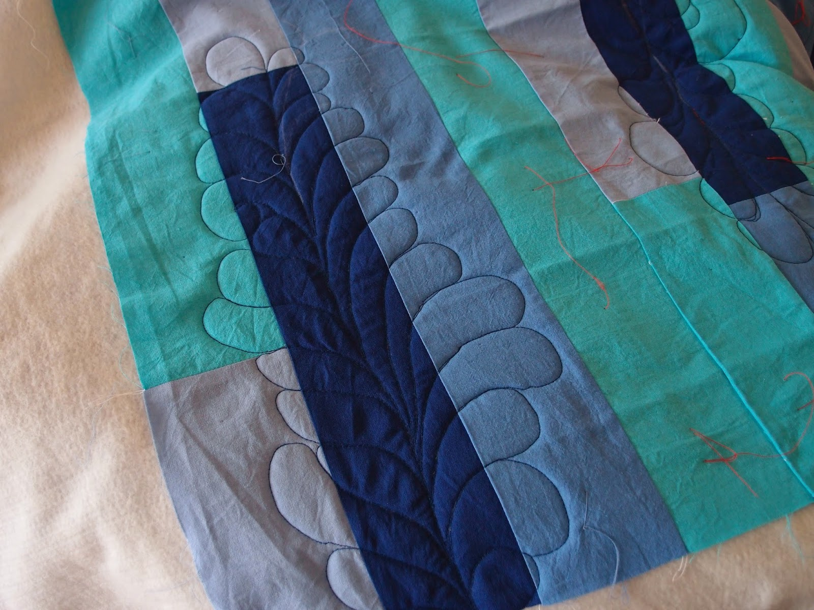 blue quilt feather quilting