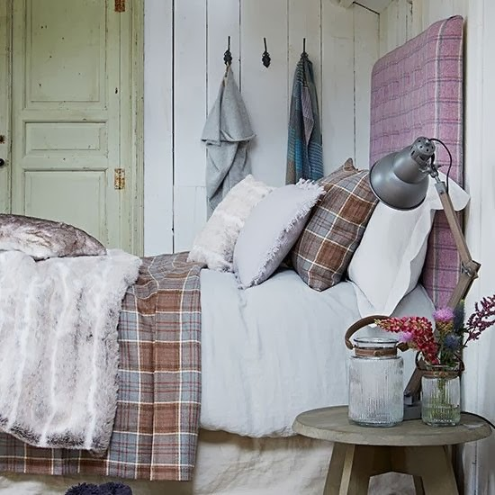 plaid headboard, plaid beddings, wood panels, old door, vintage jar, vintage stool as nightstand, throw some sort of fur on top.
