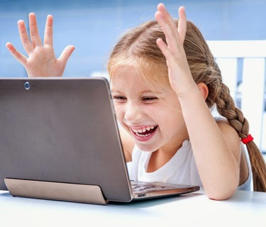 little girl with a laptop