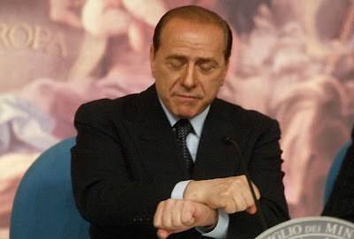 Silvio Berlusconi miming the handcuffs