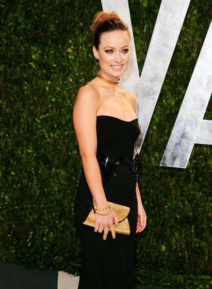 The `Cowboys & Aliens` star Olivia Wilde looked gorgeous in a black strapless silk georgette evening gown accentuated with a sequin-embroidered black velvet belt during the 2012 Vanity Fair Oscar Party hosted by Graydon Carter at Sunset Tower on February 26, 2012 in West Hollywood, California.