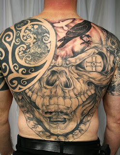 surrealistic death tattoo on the back