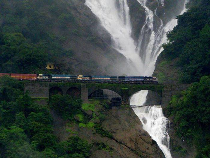Amazing railroad track located near Dudhsagar Falls, India. One of the most beautiful views you will ever see while travelling with a train.