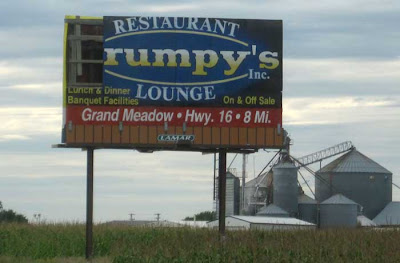 Billboard missing its first panel so that it reads RUMPY'S LOUNGE