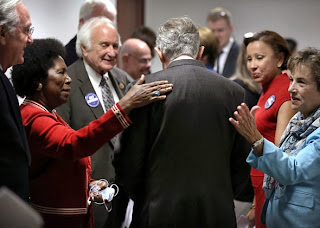 Sen. Harry Reid (D-N.V.) arrives at a ceremony as he is welcomed by, from left, Sen. Tom Harkin (D-Iowa), Rep. Sheila Jackson-Lee (D-Texas), Rep. Sander Levin (D-Mich.), Rep. Nydia Velazquez (D-N.Y.), and Rep. Jan Schakowsky (D-Ill.) on Oct. 1, 2013 on Capitol Hill in Washington.