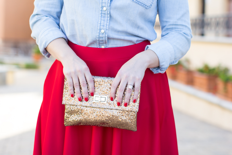 gold glitter turnlock clutch