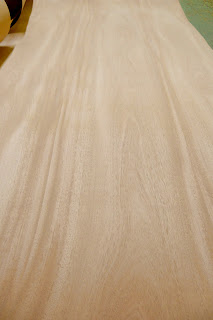 Plain Sliced Khaya veneer sheets.