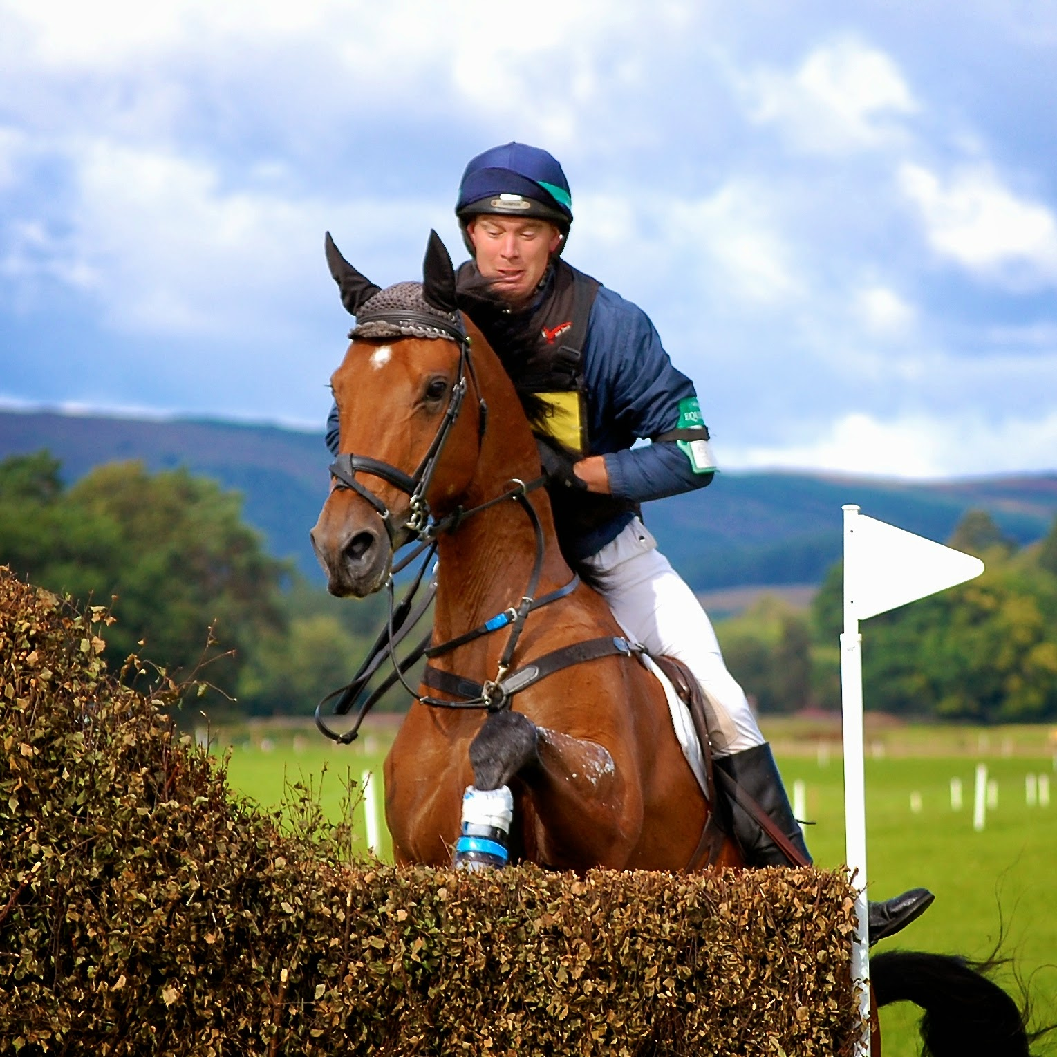 Jumping a brush fence at the Blair Castle International Horse Trials