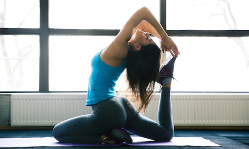 woman experiencing the benefits of yoga