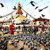 Feeding the Piegeons at Boudhanath, Kathmandu