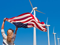 US Flag and wind farm (Photo Credit: Daniel Grill) Click to Enlarge.