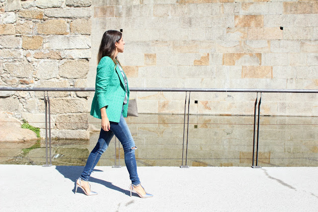 Green blazer, ripped jeans and silver heels
