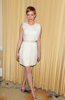 Michelle Williams in perfect ease in her white dress and gold shoes