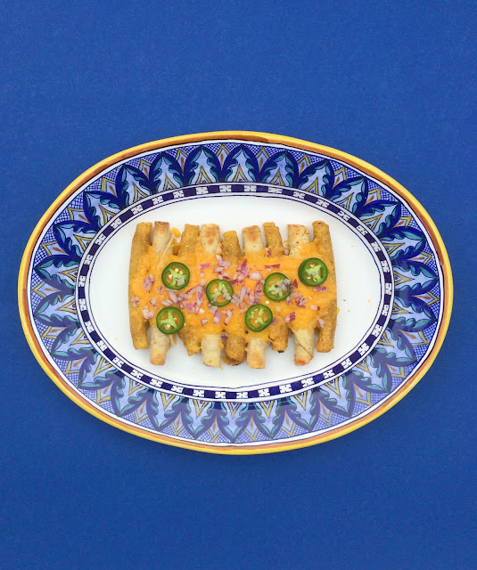 Taquito Recipe - a cheesy, delicious combination of Taquitos and Nachos | www.jacolynmurphy.com
