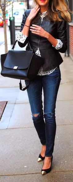 eather jacket with hand bag white shirt denim pants with high heel shoes