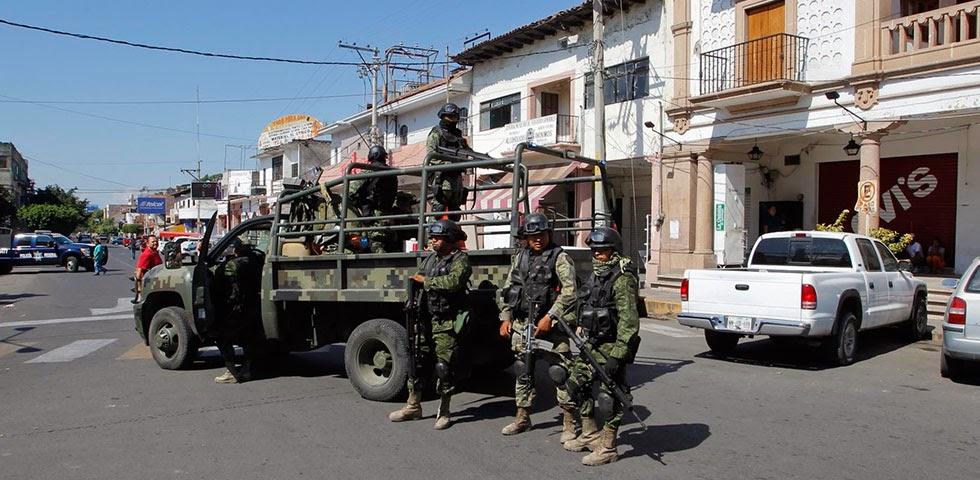 Michoacan Bajo Fuego.  Fotogaleria.  Las Victimas de Paracuaro Armadas003