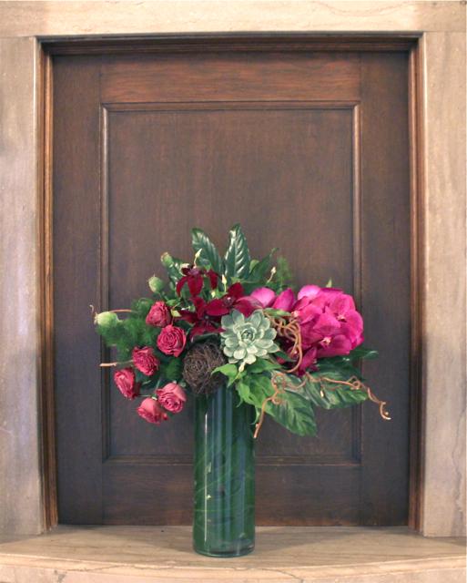 Detroit Institute of Art floral design by sweet pea floral design michigan wedding florist succulents, kiwi vine, vanda orchids, garden roses, clematis, monstera leaves tropical extra large floral arrangement at Detroit Film Theatre