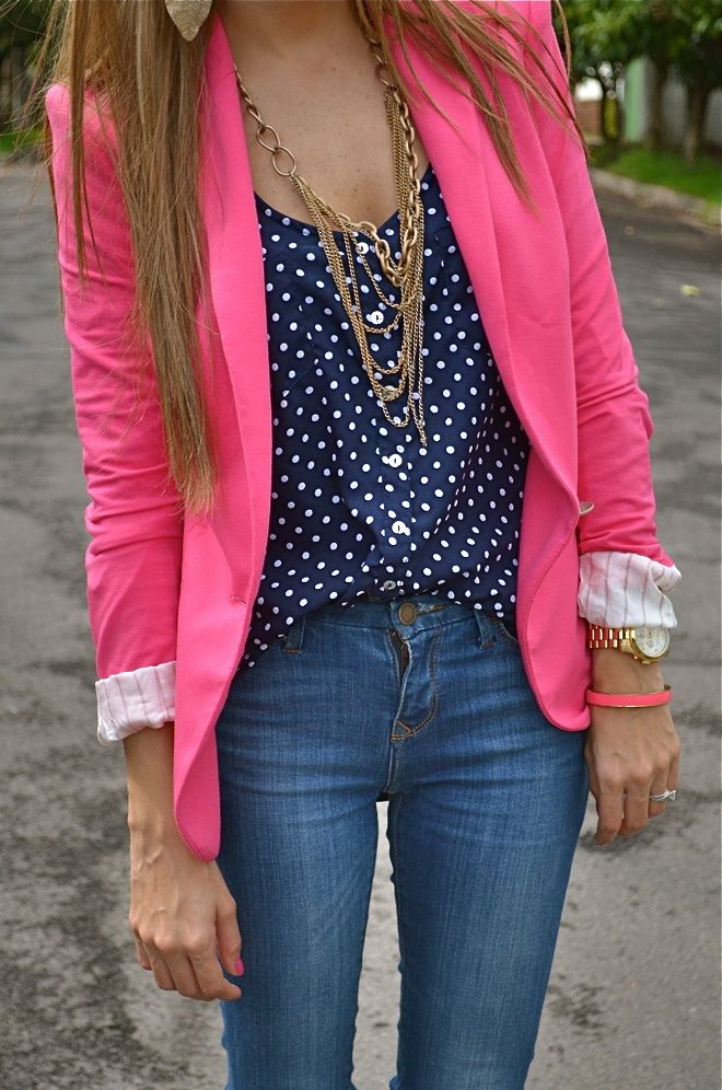 Pink blazer, black shirt, golden necklace and jeans for ladies