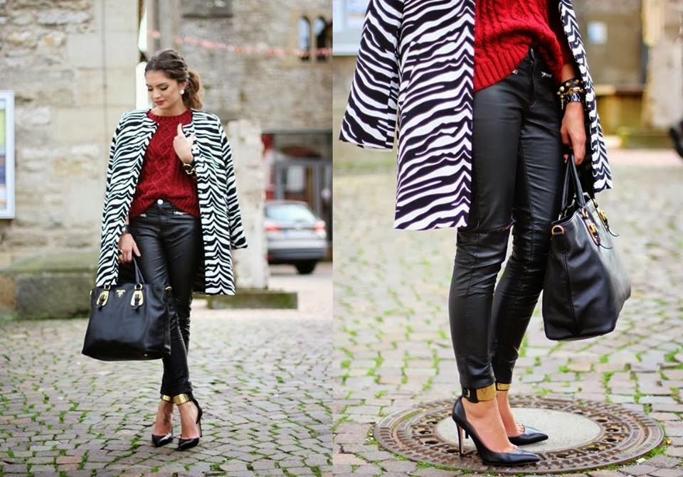 Modern Black-White Patterned Coat with Red Sweater, Amazing  Leather Trousers, Black Handbag and Stylish Golden Detailed Stiletto
