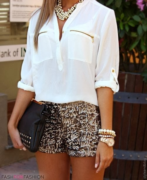 White blouse with pockets, golden shorts and hand bag fashion
