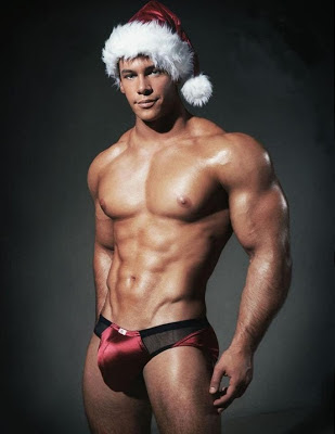 Half naked model with Santa hat