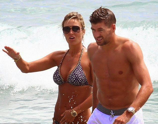 He might be spending a lot of time by training and playing football, but his national team, the Great Britain have been defeated since the first stage of World Cup 2014. But how about the athlete's spent another quality time with the buxom wife while Steven Gerrard consolidated his team beating at the beach in Ibiza, Spain on Wednesday, July 2, 2014.