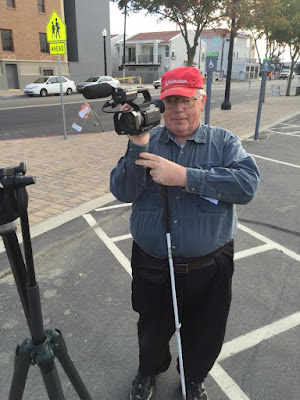 Knowing what will be in the picture is important for the camera operator. Here William Elliott uses the view finder to frame a few shots while on location photo shoot in downtown Fresno CA. Photo Kevin Hobson.