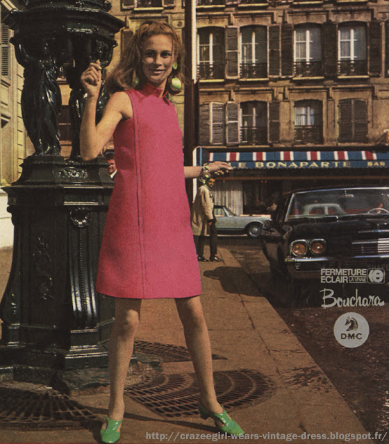 sleeveless  pink dress green patent shoes in Paris - 1967 robe rose 1960 60s années 60 mode gogo twiggy fashion mini Le Bonaparte paris france french Robe en lainage rose et sa veste , shetland de la maison Wurmser robe en toile rose , animée de panneaux géométriques soulignés de piqûres et affinant le corsage et la jupe , quatre boutons en garniture et décolleté angulaire dégageant bien le cou