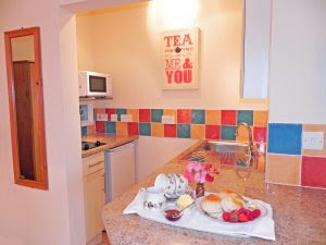 The kitchen...There is a microwave, two ringed hob, fridge, toaster and kettle..
