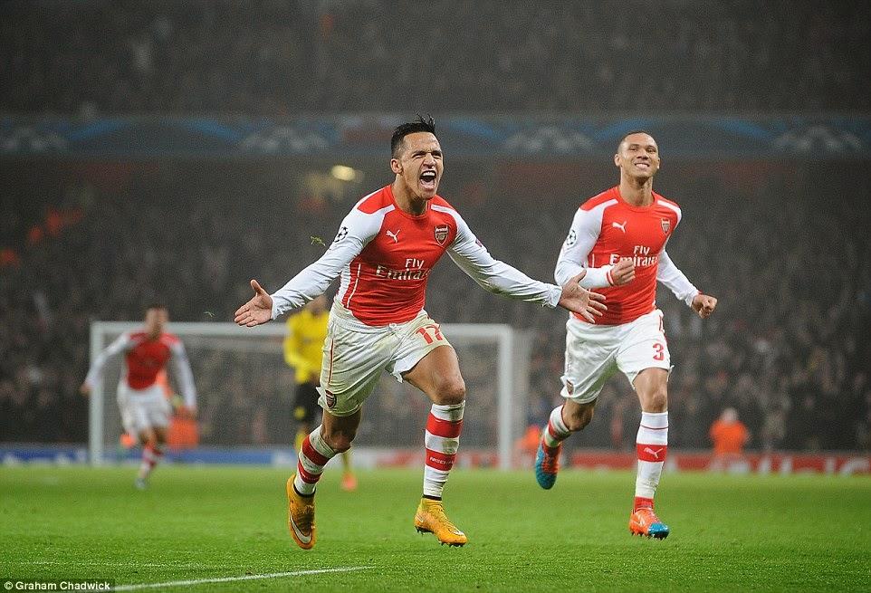 Arsenal 2-0 Borussia Dortmund: Yaya Sanogo and Alexis Sanchez strike to secure last 16 spot for Arsenal