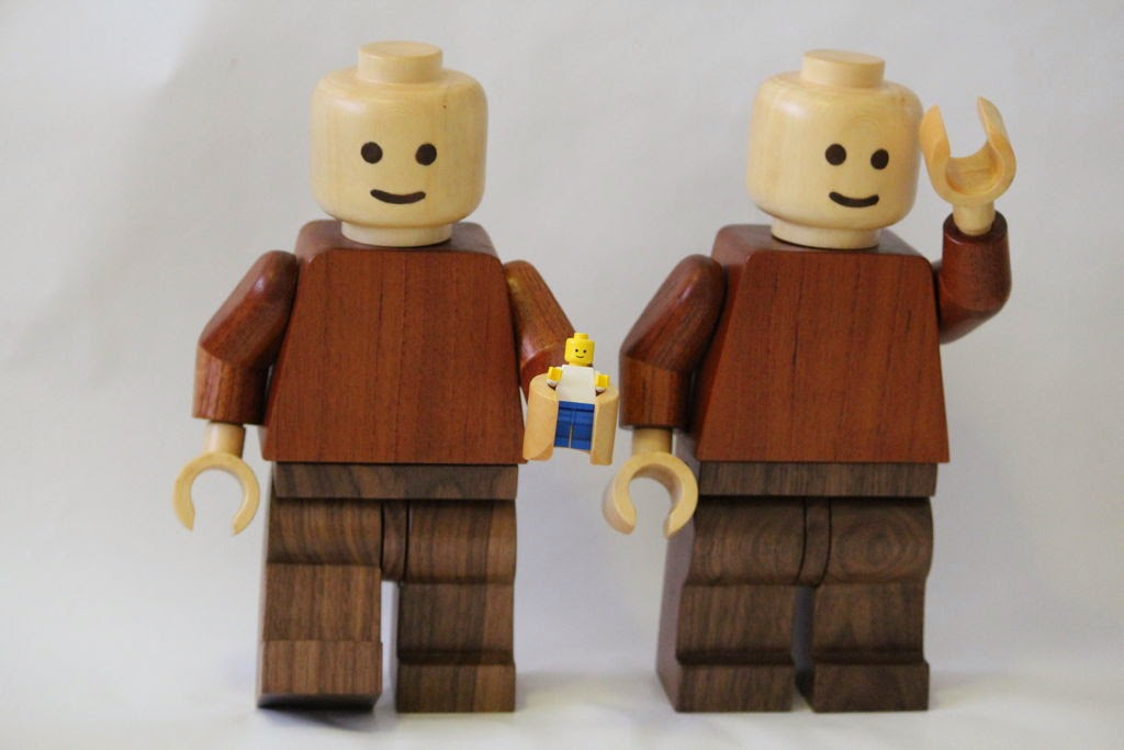 image of two large wooden lego men