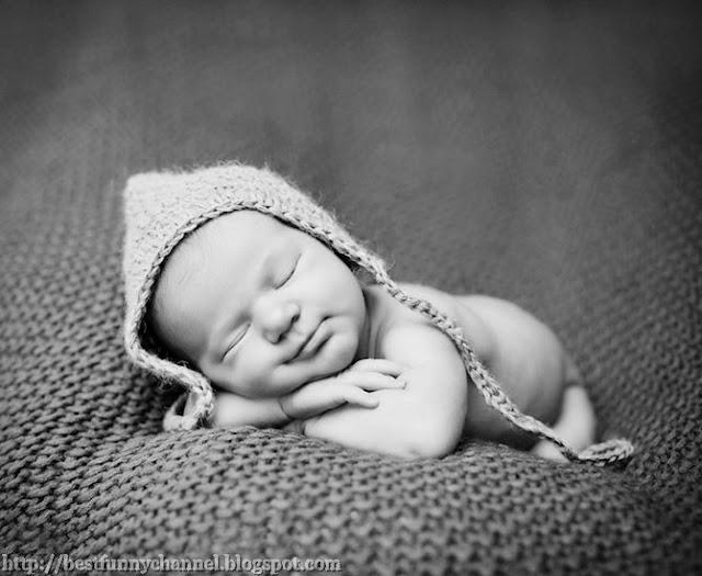 Cute baby in hat.
