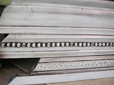 decorative molding and upholstery tacks