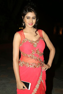 Shamili Cute Indian Model in Orange Sleeveless Deep neck Transparent Gown