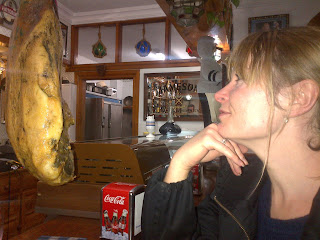woman looking at jamon in Spanish bar
