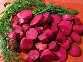 Sliced Beets with Dill on Cutting Board