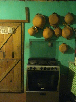 Heavy Sliding Wooden Door, Adobo Pots, One of Our Stoves