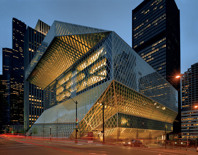 "The Seattle Public Library's Central Library is the flagship library of The Seattle Public Library system. The 11-story (185 feet or 56 meters high) glass and steel building in downtown Seattle, Washington was opened to the public on Sunday, May 23, 2004. Rem Koolhaas and Joshua Prince-Ramus of OMA/LMN were the principal architects and Hoffman Construction Company of Portland, Oregon, was the general contractor. The 362,987 square foot (34,000 m²) public library can hold about 1.45 million books and other materials, features underground public parking for 143 vehicles, and includes over 400 computers open to the public. Over 2 million individuals visited the new library in its first year. It is the third Seattle Central Library building to be located on the same site at 1000 Fourth Avenue, the block bounded by Fourth and Fifth Avenues and Madison and Spring Streets. The library has a unique, striking appearance, consisting of several discrete ""floating platforms"" seemingly wrapped in a large steel net around glass skin. Architectural tours of the building began on June 5, 2006.  In 2007, the building was voted #108 on the American Institute of Architects' list of Americans' 150 favorite structures in the US. It was one of two Seattle buildings included on the list of 150 structures, the other being Safeco Field."