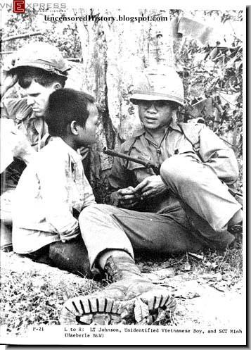 American GI chats with a Vietnamese boy