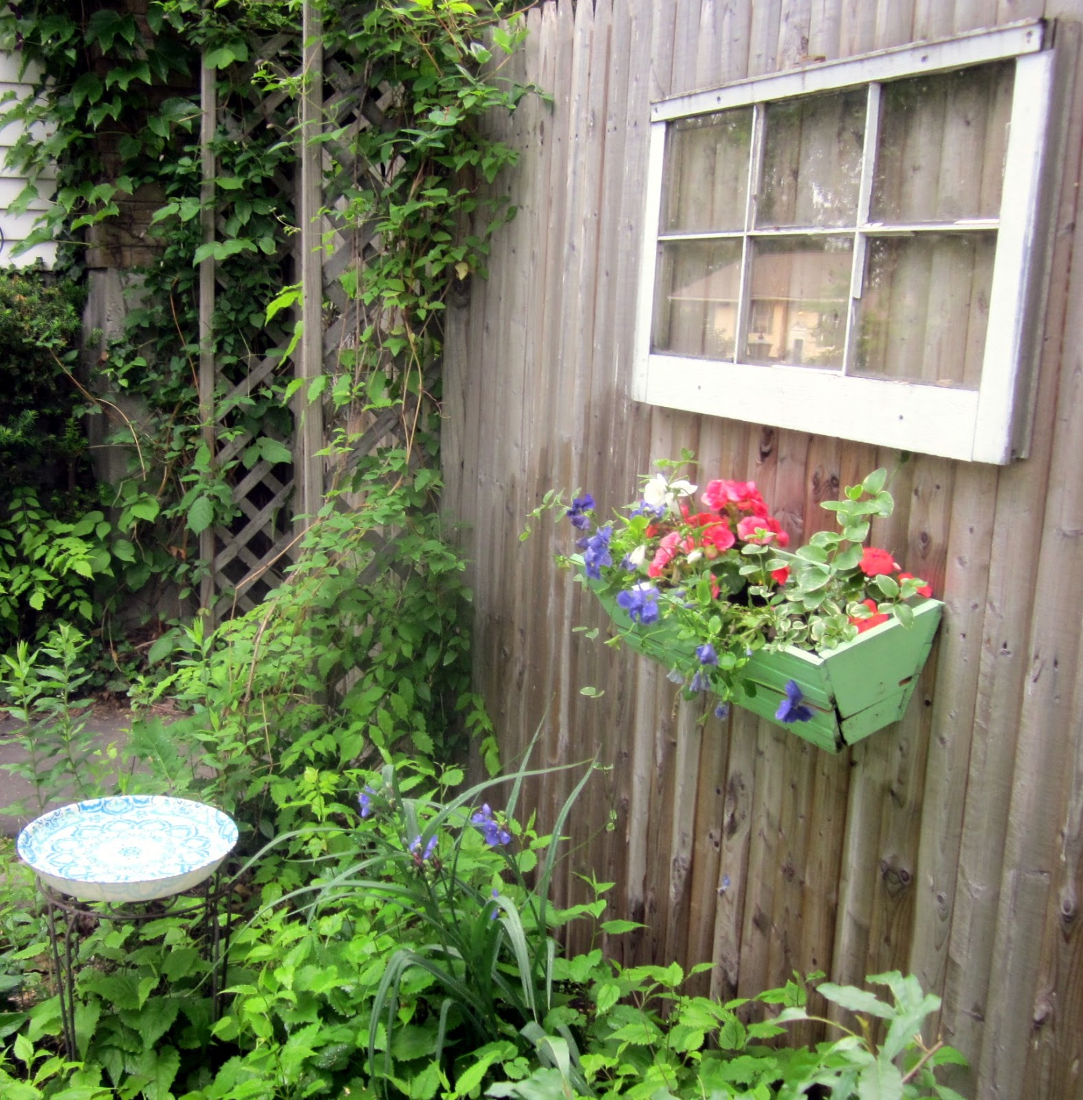 a painted journey snippets of the yard bird baths and old windows