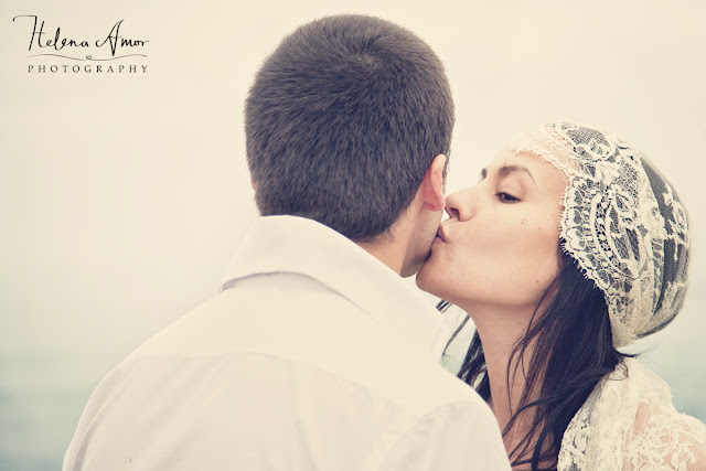 bride kissing groom at the beach