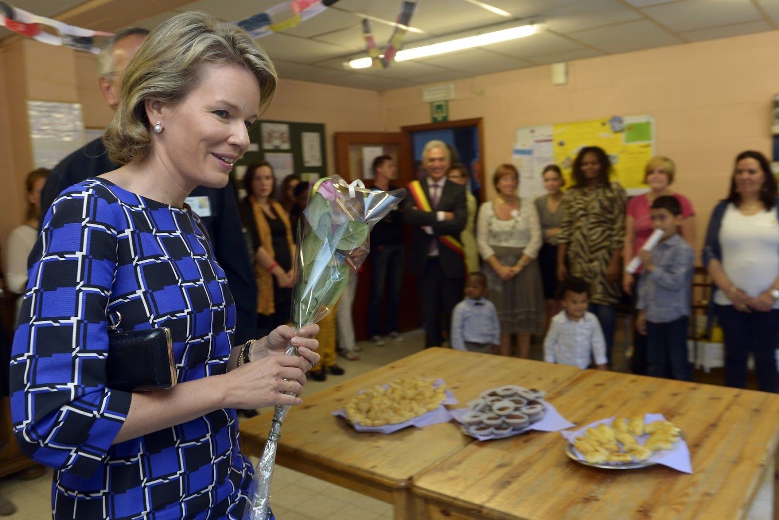 Queen Mathilde also took the time to speak with the people this work is all about, the people in need of the work of these institutions.