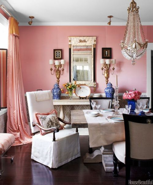 feminine and glamorous dining room with pink walls