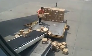 Airport worker in China throws cargo towards the plane roughly