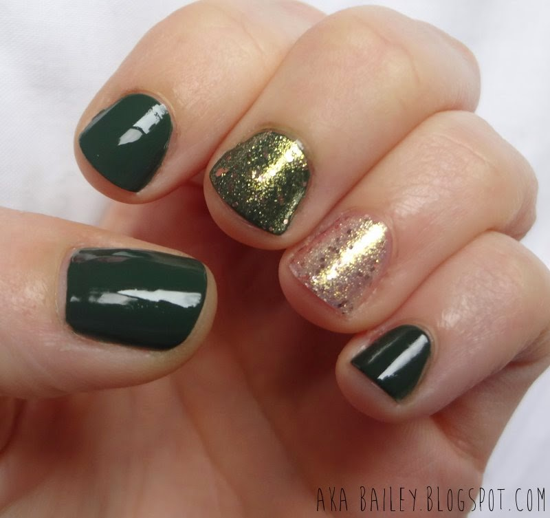 Emerald green nails with rose gold glitter accents