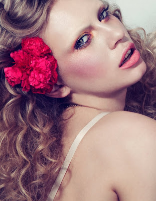 woman with flowers in hair, fragrance perfume campaign
