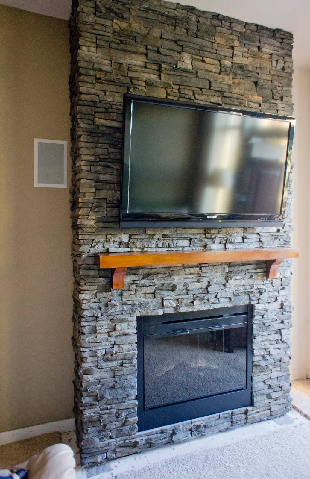 Stacked Stone Fireplace hirondelle rustique: diy stacked stone fireplace (first remodeling