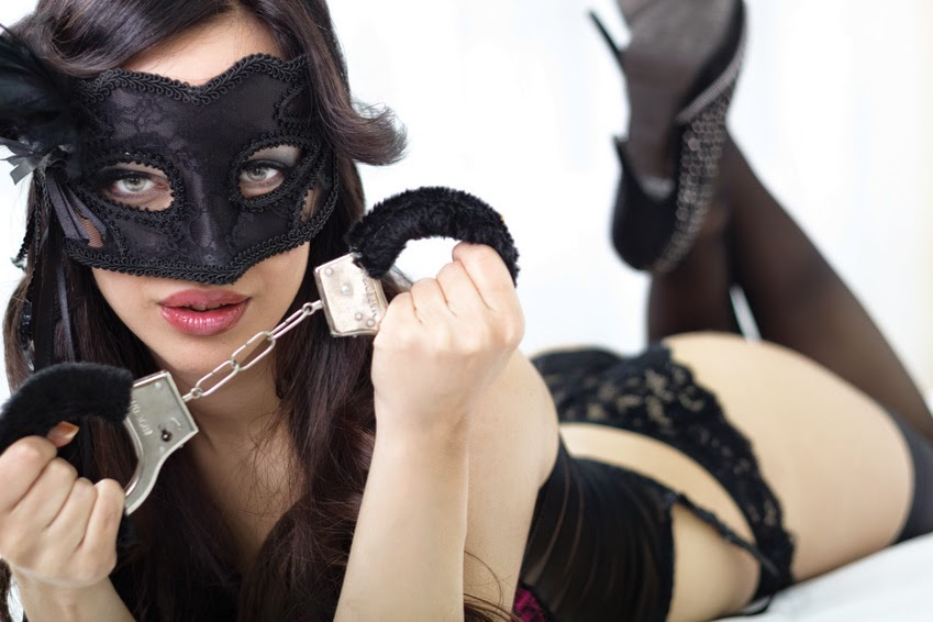 SexyYoung Woman in Sexy Lingerie Holds Handcuffs