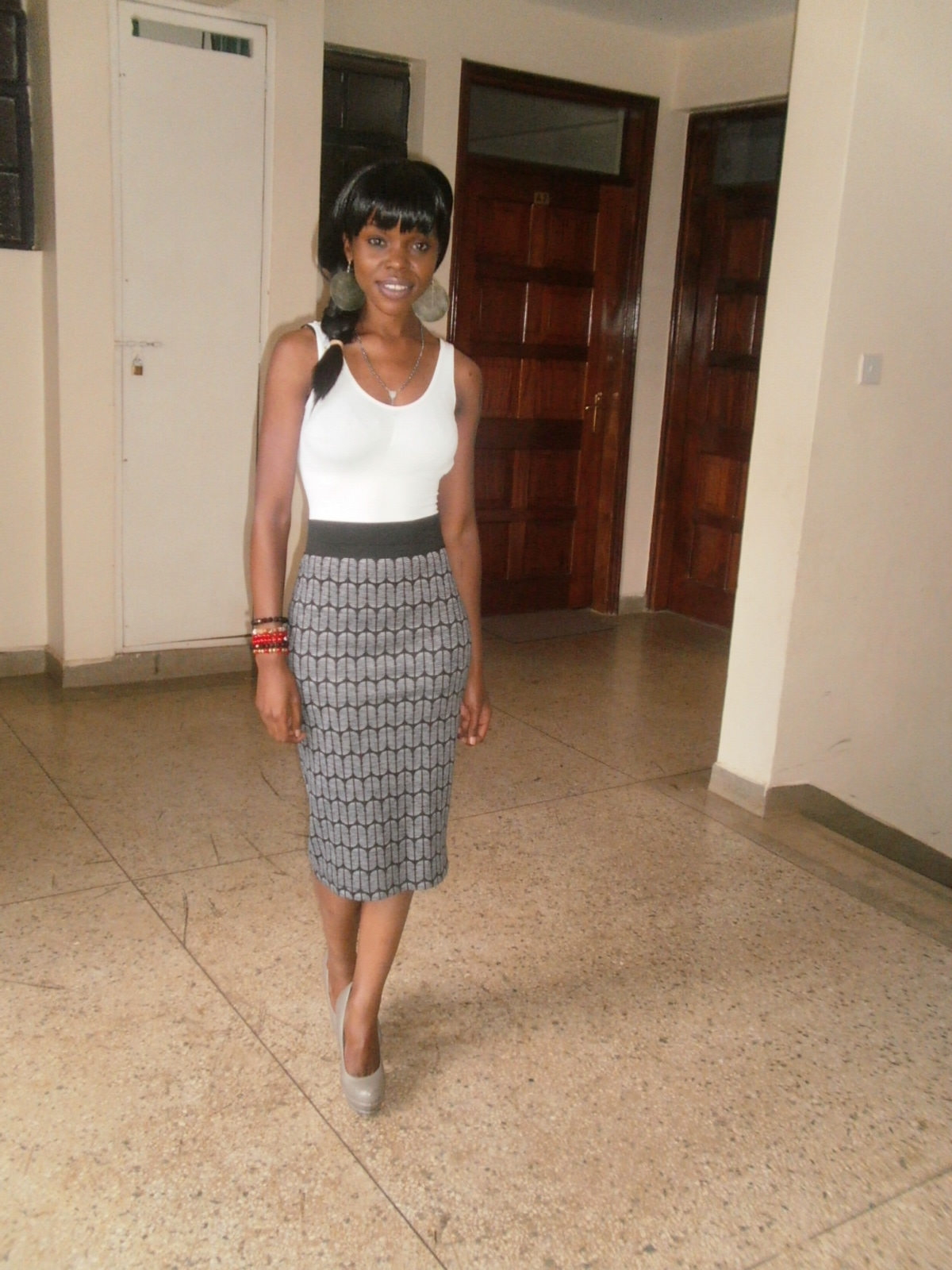 nyangi styles personal style interview barbara isiaho my outfit for the night is a little girly but glamorous a fancy skirt a simple flattering vest and heels i like this outfit because it brings out all