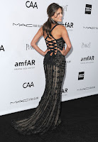 Alessandra Ambrosio shows off her dress at amfAR's 3rd Annual Inspiration Gala